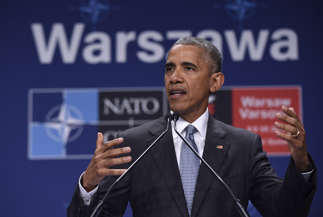 President Barack Obama speaks about the events in Dallas at the beginning of his news conference at PGE National Stadium in Warsaw, Poland, Saturday, July 9, 2016. (Susan Walsh/The Associated Press)