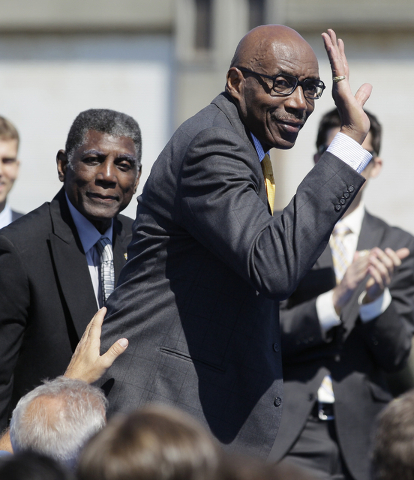 Golden State Warriors great Nate Thurmond waves during a 2012 announcement in San Francisco that the NBA basketball team wants to return to San Francisco. (Eric Risberg/The Associated Press)