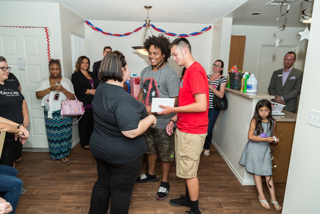 Former foster children were presented with the first keys to their home during a ceremony at Olive Crest's Project Independence facility in Las Vegas, June 1.  (Special to View)