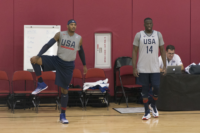 Forward Carmelo Anthony (15), left, and forward, Draymond Green (14) stretch during a USA men's basketball Olympic team practice at UNLV's Mendenhall Center in Las Vegas Tuesday, July 19, 2016. (J ...