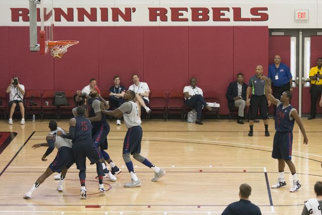 Forward Harrison Barnes (8), right, shoots a free throw during a USA men's basketball Olympic team practice at UNLV's Mendenhall Center in Las Vegas Tuesday, July 19, 2016. (Jason Ogulnik/Las Vega ...
