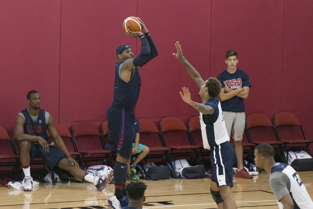 Forward Carmelo Anthony (15), second from left, shoots the ball during a USA men's basketball Olympic team practice at UNLV's Mendenhall Center in Las Vegas Tuesday, July 19, 2016. (Jason Ogulnik/ ...