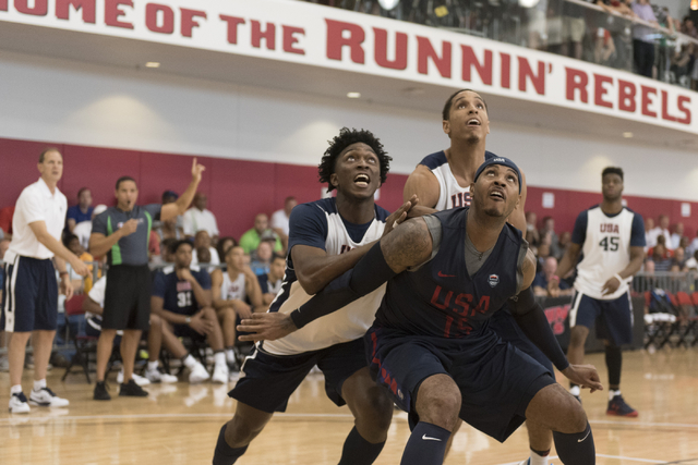 Forward Carmelo Anthony (15), right, positions himself for a rebound during a USA men's basketball Olympic team practice at UNLV's Mendenhall Center in Las Vegas Tuesday, July 19, 2016. (Jason Ogu ...