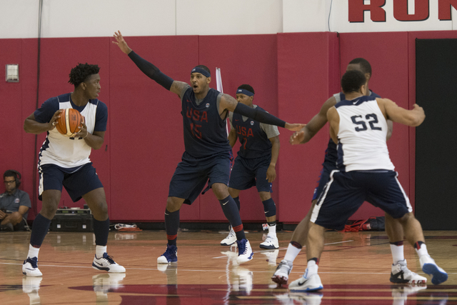 Forward Carmelo Anthony (15), second from left, plays defense during a USA men's basketball Olympic team practice at UNLV's Mendenhall Center in Las Vegas Tuesday, July 19, 2016. (Jason Ogulnik/La ...