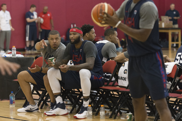 Center DeMarcus Cousins (12), second from left, and Jeff Capel, associate head coach with Duke University, left, talk while sitting on the bench during a USA men's basketball Olympic team practice ...