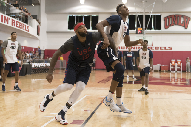 Center DeMarcus Cousins (12), left, positions himself for a rebound during a USA men's basketball Olympic team practice at UNLV's Mendenhall Center in Las Vegas on Wednesday, July 20, 2016. Jason  ...