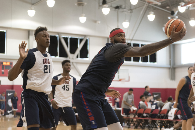 Center DeMarcus Cousins (12), right, prepares to shoot the ball during a USA men's basketball Olympic team practice at UNLV's Mendenhall Center in Las Vegas on Wednesday, July 20, 2016. Jason Ogul ...