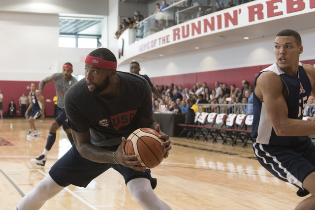 Center DeMarcus Cousins (12), left, prepares to shoot the ball during a USA men's basketball Olympic team practice at UNLV's Mendenhall Center in Las Vegas on Wednesday, July 20, 2016. Jason Oguln ...