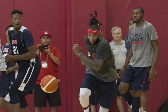 DeMarcus Cousins (12), center, runs for a loose ball during a USA men's basketball Olympic team practice at UNLV's Mendenhall Center in Las Vegas on Wednesday, July 20, 2016. Jason Ogulnik/Las Veg ...