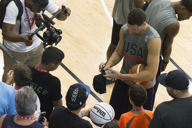 Guard Klay Thompson (11), right, signs autographs for fans during a USA men's basketball Olympic team practice at UNLV's Mendenhall Center in Las Vegas Thursday, July 21, 2016. (Jason Ogulnik/Las  ...