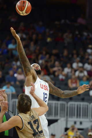 United States' DeMarcus Cousins jumps for the ball during  the tipoff of the U.S. men's basketball team exhibition game versus Argentina on Friday, July 22, 2016 at T-Mobile Arena. (Bridget Bennet ...