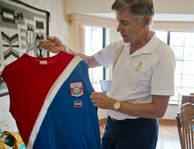 Larry Brickner shows off one of his Olympic athlete uniforms inside his Las Vegas home on Sunday, July 24, 2016. Brickner will be attending his eleventh Olympic Games when he travels to Rio de Jan ...