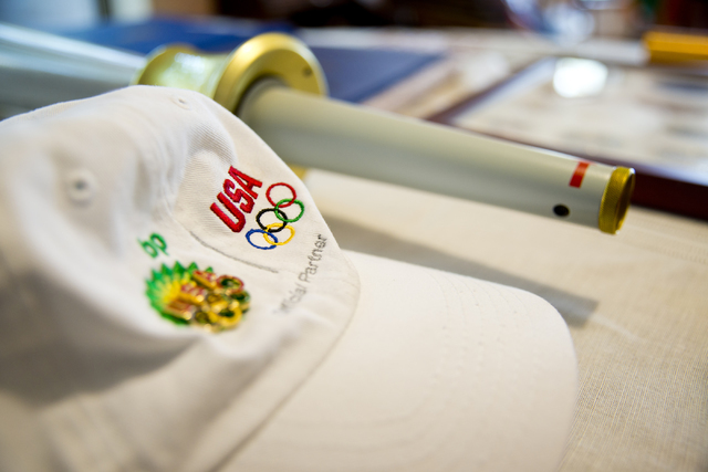 An Olympic hat is seen on a table inside Larry Brickner's home in Las Vegas on Sunday, July 24, 2016. Brickner will be attending his eleventh Olympic Games when he travels to Rio de Janeiro, Brazi ...