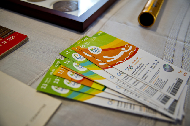 Larry Brickner's 2016 Olympic Games tickets lie on a table inside his Las Vegas home on Sunday, July 24, 2016. Brickner will be attending his eleventh Olympic Games when he travels to Rio de Janei ...