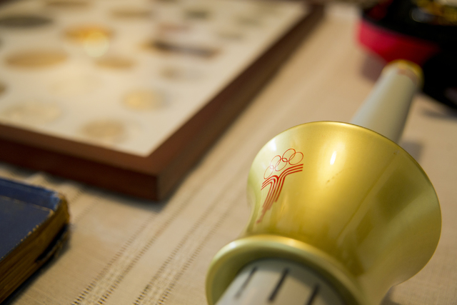 A Olympic torch is seen on a table inside Larry Brickner's home in Las Vegas on Sunday, July 24, 2016. Brickner will be attending his eleventh Olympic Games when he travels to Rio de Janeiro, Braz ...