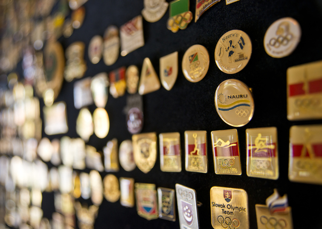 Larry Brickner's collection of Olympic Games pins adorn a wall inside his Las Vegas home on Sunday, July 24, 2016. Brickner will be attending his eleventh Olympic Games when he travels to Rio de J ...