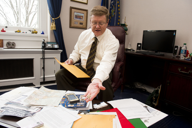 In his Capitol Hill office on Tuesday, Rep. Mark Amodei, R-Nev., displays the lapel pin, license plate and other items given to members of Congress before a new session. Photo by Lisa Helfert, spe ...
