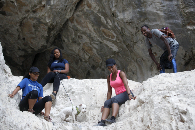 Toy Mahoney, from left, Marckia Hayes, Dara Udoh, and Antoine Freeman negotiate a rock slope at Mary Jane Falls on Saturday, June 25, 2016 in Mount Charleston. Rachel Aston/Las Vegas Review-Journa ...