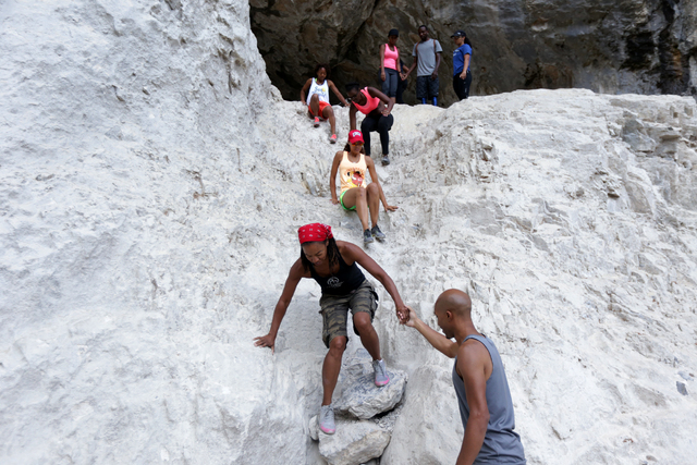 Members of Outdoor Afro descend a rock slope at Mary Jane Falls on Saturday, June 25, 2016 in Mount Charleston. Rachel Aston/Las Vegas Review-Journal Follow @rookie__rae
