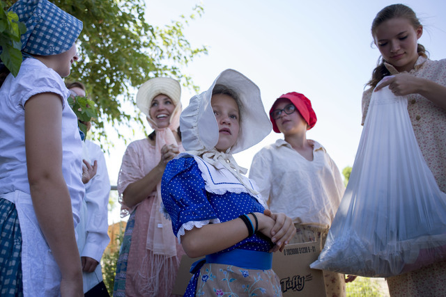 Emily Whimple, center, rests with other women and children before participating in the parade during the celebration of Pioneer Day on Saturday, July 23, 2016, in Panaca, Nev. (Bridget Bennett/Las ...