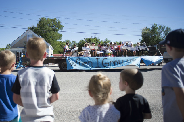 A float passes by children on the sidewalk during a Pioneer Day celebration on Saturday, July 23, 2016, in Panaca, Nev. (Bridget Bennett/Las Vegas Review-Journal) Follow @bridgetkbennett