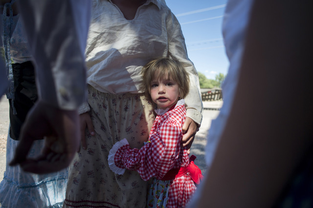 Cassandra Whimple, 3, clings to her sister May Whimple, 12,  during a Pioneer Day celebration on Saturday, July 23, 2016, in Panaca, Nev. (Bridget Bennett/Las Vegas Review-Journal) Follow @bridget ...