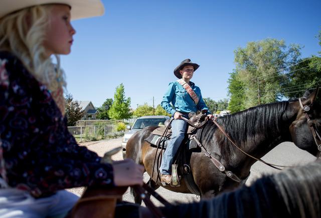 Kailey Lee, left, and Abigail Frehner, right, sit atop horses prior participating in the Poneer Day parade on Saturday, July 23, 2016, in Panaca, Nev. (Bridget Bennett/Las Vegas Review-Journal) Fo ...