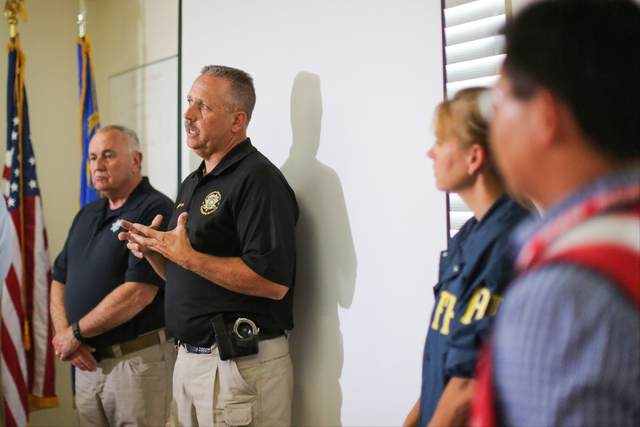 Lincoln County Sheriff Kerry Lee, center, and Director of the Nevada Department of Public Safety James Wright, left, hold a briefing on Thursday, July 14, 2016, about a Wednesday night bombing tha ...