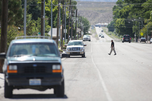 A police officer crosses the road toward where a Wednesday night bombing killed one in Panaca, Nev., on Thursday, July 14, 2016. Brett Le Blanc/Las Vegas Review-Journal Follow @bleblancphoto