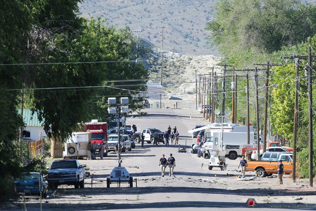 Police investigate shrapnel from a Wednesday night bombing that killed one person on Fifth Street in Panaca, Nev., on Thursday, July 14, 2016. Brett Le Blanc/Las Vegas Review-Journal Follow @blebl ...