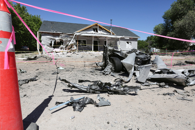 Damage from a Wednesday night bombing that killed one on 5th street in Panaca, Nev., tore a car in half and left a house uninhabitable is seen on Friday, July 15, 2016. Brett Le Blanc/Las Vegas Re ...