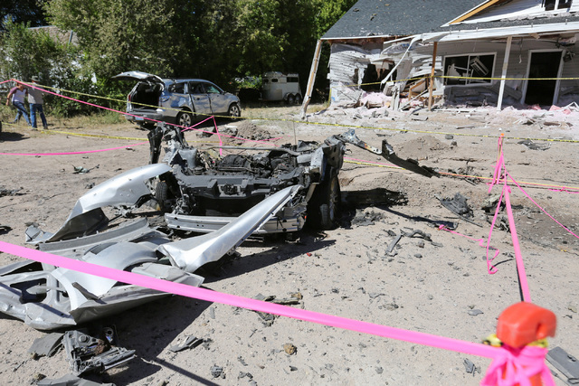 Damage from a July 13 bombing that killed one person on 5th street in Panaca, Nev., tore a car in half and left a house uninhabitable, is seen on Friday, July 15, 2016. (Brett Le Blanc/Las Vegas R ...