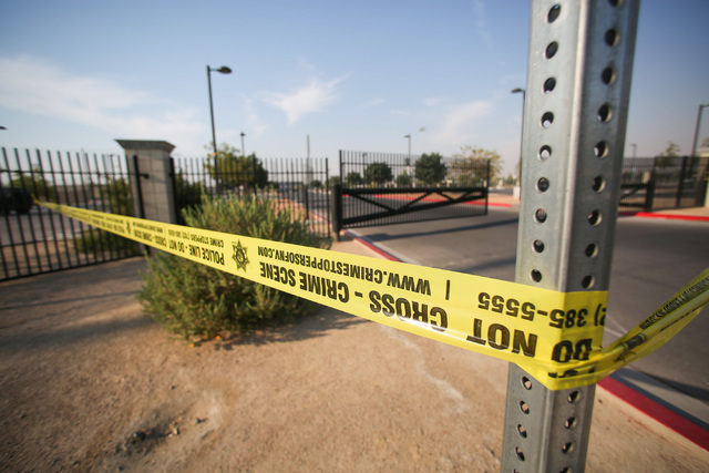 Police tape hangs at Gary Reese Freedom Park where Las Vegas police say a shooting erupted when a man in a vehicle attempted to rob Pokemon Go players early Monday morning, July 25, 2016. (Brett L ...