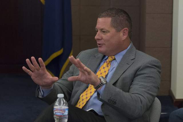 Trent Matson, director of government affairs with Moneytree, Inc., speaks during a summit to discuss payday loans and their dangers at the Sawyer Building in Las Vegas Friday, July 8, 2016. Jason  ...