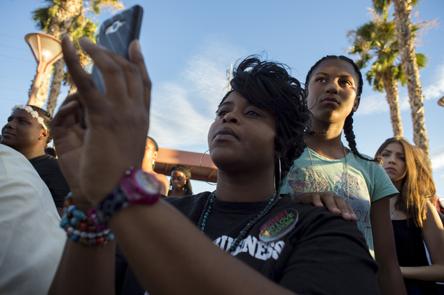 Paula Jacksun, 12, places her hand on her mother Freda Jacksun's shoulder during the rally on the evening of Saturday, July 9, 2016 at Martin Luther King Boulevard and Carey Avenue in Las Vegas. ( ...