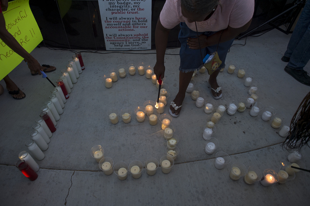 Sunny Davis, center, light candles during a rally on the evening of Saturday, July 9, 2016 at Martin Luther King Boulevard and Carey Avenue in Las Vegas. (Bridget Bennett/Las Vegas Review-Journal) ...