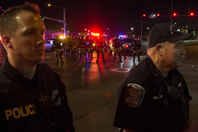Police with riot gear make their way into the intersection of Martin Luther King Boulevard and Carey Avenue on evening of Saturday, July 9, 2016 in Las Vegas. (Bridget Bennett/Las Vegas Review-Jou ...