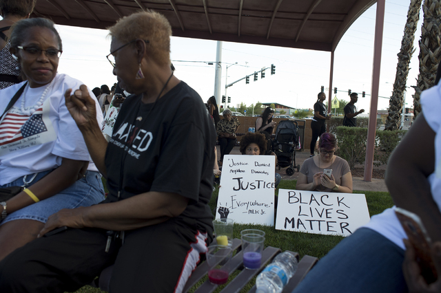 Sydni Johnson, left, holds sings with her mother Becky Johnson, right, on Saturday, July 9, 2016, in Las Vegas at the intersection of Martin Luther King Boulevard and Carey Avenue. (Bridget Bennet ...