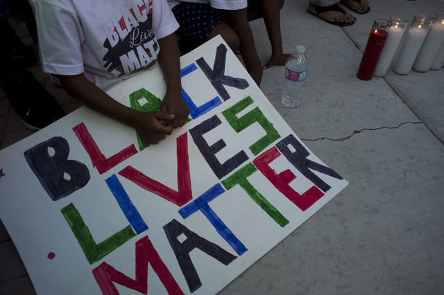 A child holds a sign during the demonstration on Saturday, July 9, 2016, in Las Vegas at the intersection of Martin Luther King Boulevard and Carey Avenue. (Bridget Bennett/Las Vegas Review-Journa ...