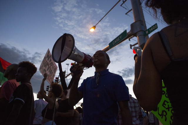 A demonstrator yells on megaphone on Saturday, July 9, 2016, in Las Vegas at the intersection of Martin Luther King Boulevard and Carey Avenue. (Bridget Bennett/Las Vegas Review-Journal) Follow @b ...