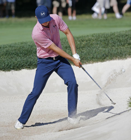 Jordan Spieth hits from a sand trap on third hole during a practice round for the PGA Championship golf tournament at Baltusrol Golf Club in Springfield, N.J., Tuesday, July 26, 2016. (Mike Groll/AP)