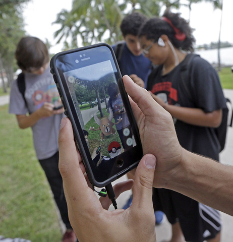 Pinsir, a Pokemon, is found by a group of Pokemon Go players at Bayfront Park in downtown Miami on July 12. (Alan Diaz/The Associated Press)