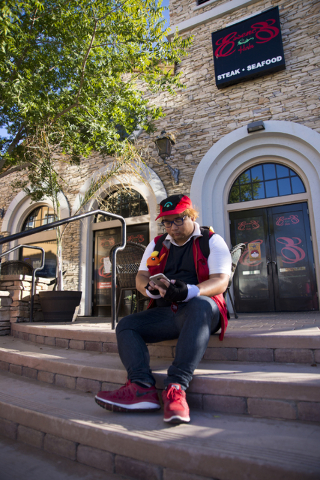 """Julian Abrera uses the Pokemon Go app during a Pokemon Go """"Meet and Eat"""" event at Lake Las Vegas on Tuesday, July 19, 2016. The event was organized by Chanthy Walsh who owns two  ..."""