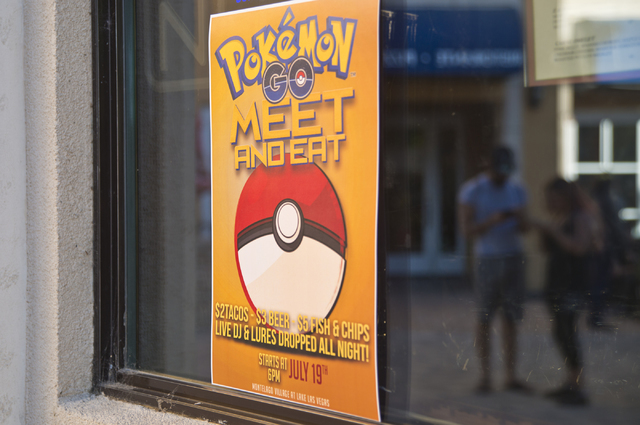 """A sign advertises a Pokemon Go """"Meet and Eat"""" event at Lake Las Vegas on Tuesday, July 19, 2016. The event was organized by Chanthy Walsh who owns two restaurants inside The Vill ..."""