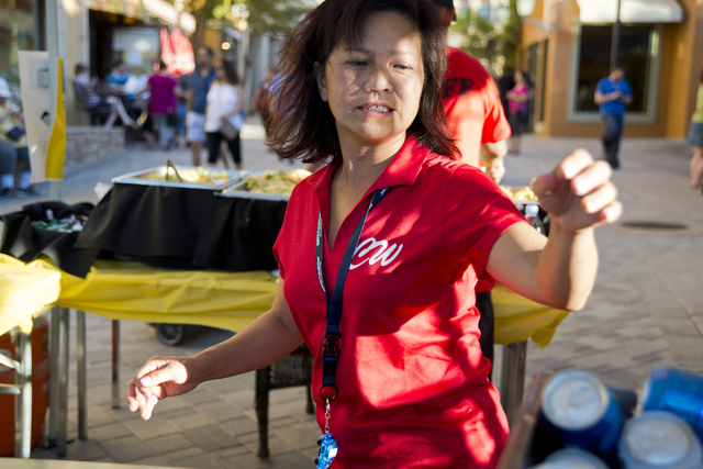 """Chanthy Walsh helps serve food during a Pokemon Go """"Meet and Eat"""" event at Lake Las Vegas on Tuesday, July 19, 2016. The event was organized by Walsh who owns two restaurants ins ..."""