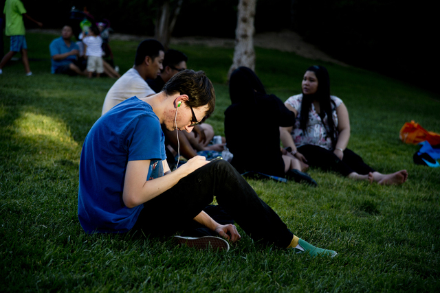 """Dylan Gilbert uses the Pokemon Go app during a Pokemon Go """"Meet and Eat"""" event at Lake Las Vegas on Tuesday, July 19, 2016. The event was organized by Chanthy Walsh who owns two  ..."""