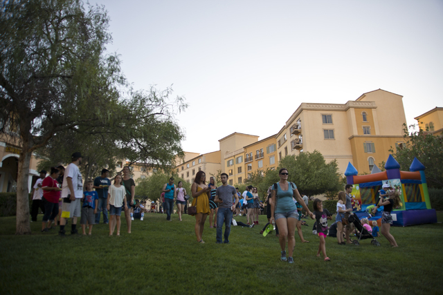 """Visitors spread out on the lawn during a Pokemon Go """"Meet and Eat"""" event at Lake Las Vegas on Tuesday, July 19, 2016. The event was organized by Chanthy Walsh who owns two restau ..."""