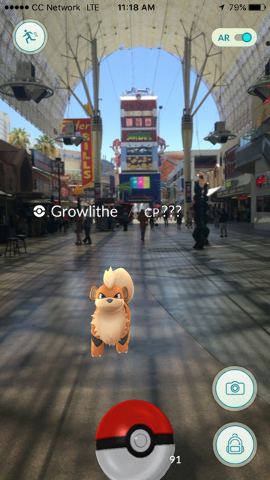 A Growlithe is seen at the Fremont Street Experience on the screen of a Pokemon Go user in downtown Las Vegas, on Wednesday, July 13, 2016. (Kristen DeSilva/Las Vegas Review-Journal Follow @kriste ...