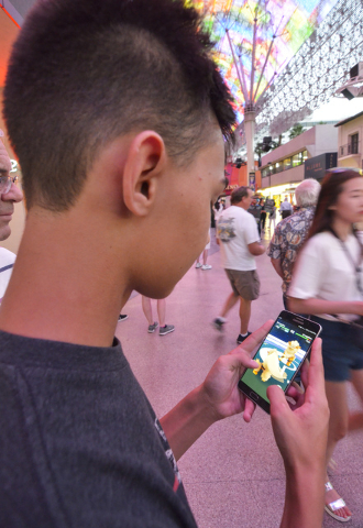 "Kolby Stevenson of Las Vegas plays ""Pokemon Go"" along the Fremont Street Experience in downtown Las Vegas on Wednesday, July 13, 2016. (Bill Hughes/Las Vegas Review-Journal)"