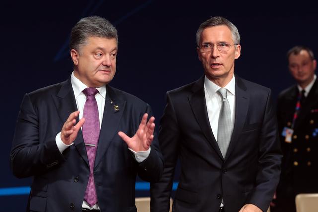 NATO Secretary General Jens Stoltenberg and Ukraine's President Petro Poroshenko to a working session of the NATO-Ukraine Commission at  the NATO summit in Warsaw, Poland, Saturday, July 9, 2016.  ...